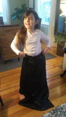 C. modeling the 90's skirt